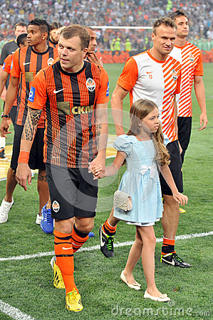 Shakhtar players and girl Editorial Stock Photo