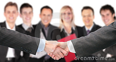Shaking hands and business group out of focus