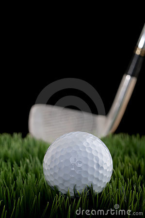 Shallow focus image of a golf ball and club