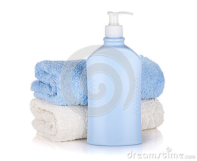 Shampoo bottle and towels