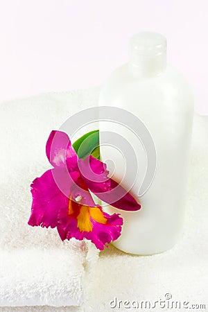 bottle, orchid & towels