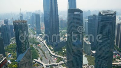 Shanghai, China - May 21, 2019: Financial Center With Skyscrapers And Tower. Shanghai, China - May 21, 2019: Shanghai cityscape at sunny day in Lujiazui stock video