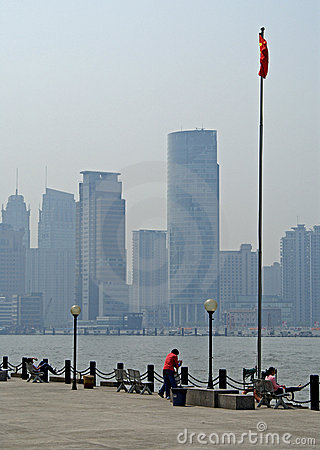 Shanghai riverfront with flag