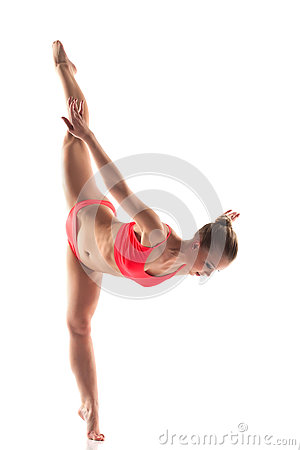 Shapely young woman doing gymnastics splits