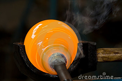 Shaping a melted glass bubble