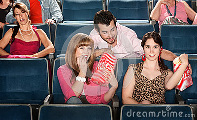 Sharing Popcorn in a Theater