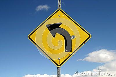 Sharp Left Turn Sign