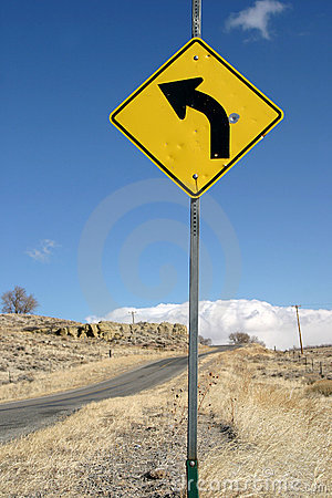 Sharp Left Turn Sign