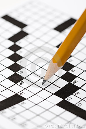 A sharp pencil on a crossword puzzle