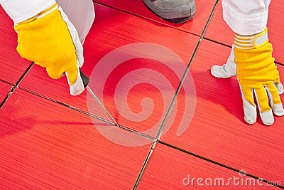 Sharp tool clean spaces between tiles