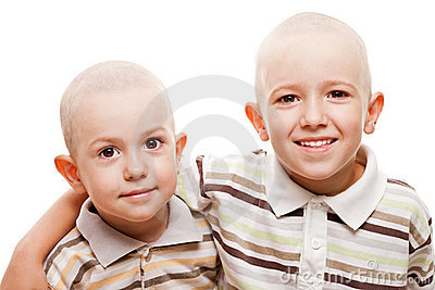 Shaved heads children smiling