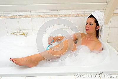 Shaving her legs