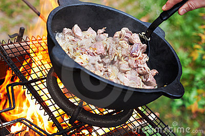 Sheep meat fried with onions in oil