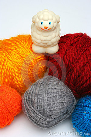 Free Sheep Over Balls Of Yarn Royalty Free Stock Photo - 597395