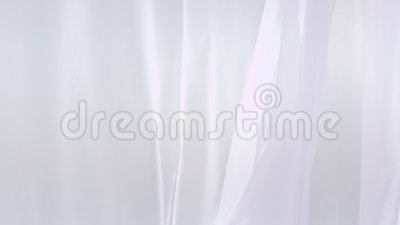 Sheer white curtains blowing in the wind stock video video 76542177