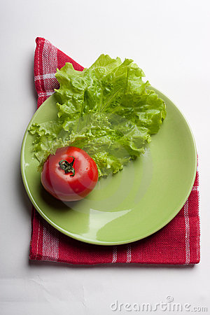 Sheet green lettuce and red tomato