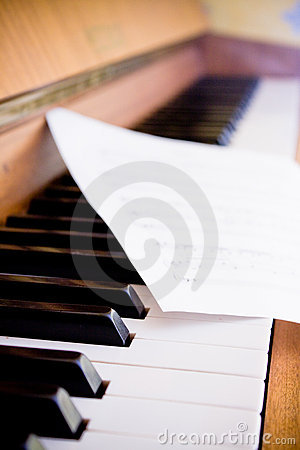 Sheet music and piano