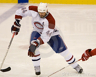 Sheldon Souray Chases The Puck Editorial Stock Photo