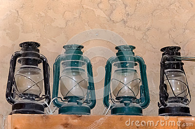 shelf of dusty lanterns