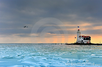 Shelf ice and lighthouse in Marken