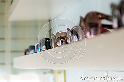 Shelf of sunglasses