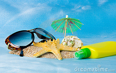 Shell, glasses, starfish and sun lotion
