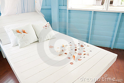 Shellfish with white pillow on the bed