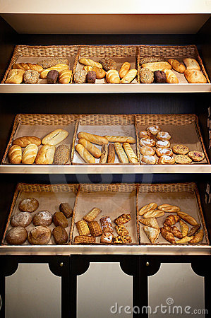 Shelves with bread at store