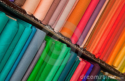 Shelves of colorful textiles and fabrics