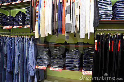 Shelves and racks with clothes in shop