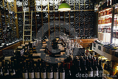 Shelves of wine bottles in a wine store Editorial Photo