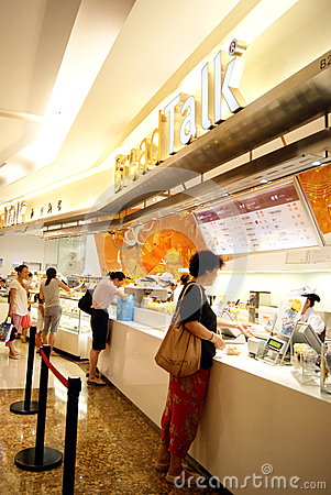 Shenzhen china: bread shops and consumers Editorial Stock Photo