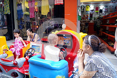 Shenzhen china: children playing with the toy car Editorial Photo
