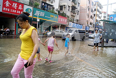Shenzhen china: underground water pipes burst, water flow into the river Editorial Stock Photo