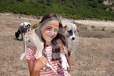 Shepherd girl with puppy