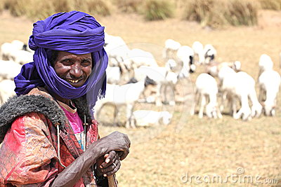 Shepherd herding his goat Editorial Stock Image