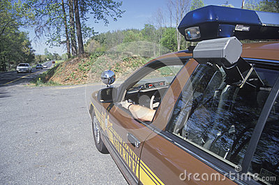 Sheriff sitting in car Editorial Stock Image