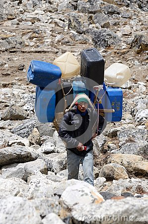 Sherpa porter carry heavy load in the Himalaya at Everest Base Camp trek,Nepal Editorial Stock Image