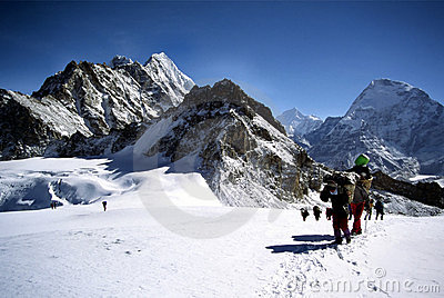 Sherpas and climbers crossing an Himalayam glacier