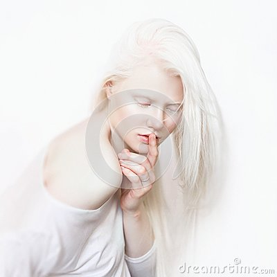 Free Shhh Gesture. Albino Female With White Skin And White Long Hair. Photo Face On A Light Background. Blonde Girl Stock Image - 102459051