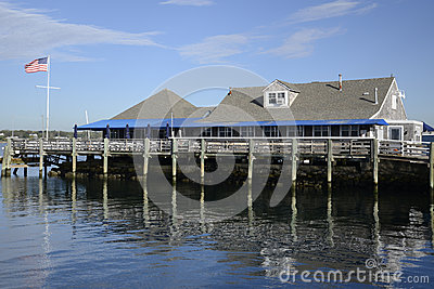 Shingle building by water and dock