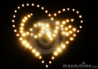 Shining golden abstract heart and love