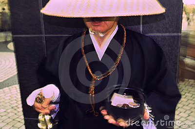 Shinto Monk Ringing Donation Bell in Tokyo Editorial Photography
