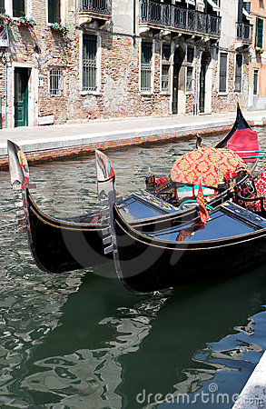 Shiny black gondolas in the canals of Venice