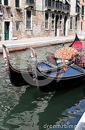 Shiny black gondolas in the canals of Venice