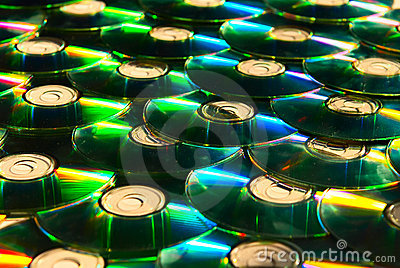 Shiny cd discs lie on each other and shine
