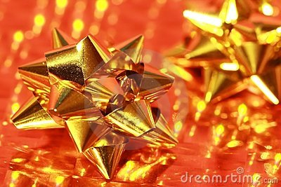 Shiny gold of gift bow on gold