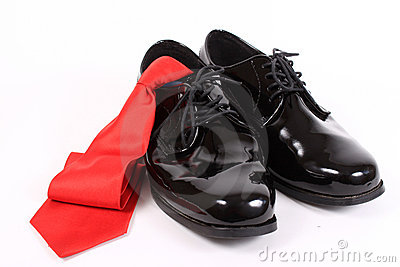 Shiny men s dressy shoes and red tie