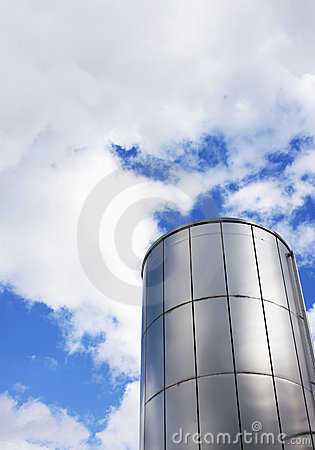 Shiny metal chimney and cloudy skies