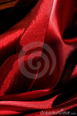 Shiny red fabric folds